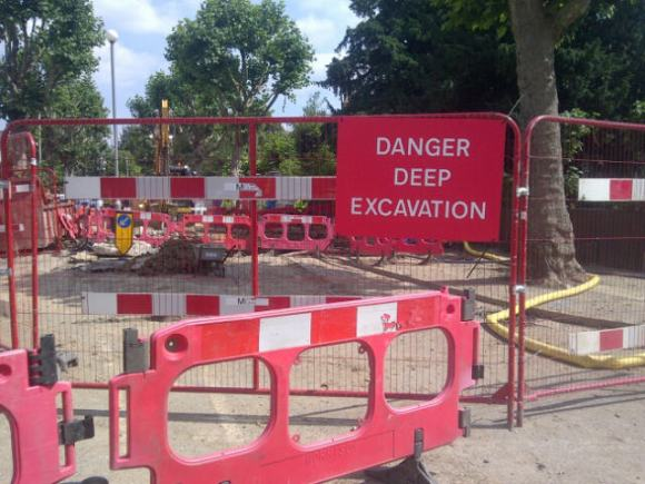 Men at Work - Thames Water contractors starting work on the burst main pipe 8th Aug 2013