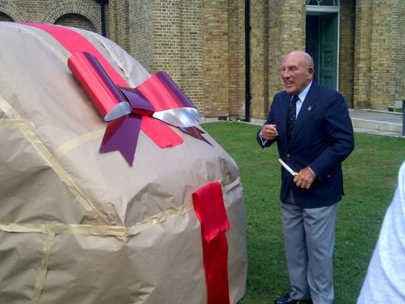 Sir Stirling Moss cuts the ribbon on the Artmobile on Tues 10th Sept